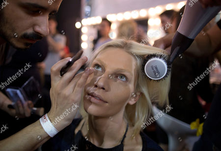 Aline Weber Brazilian model Aline Weber has her makeup and hair done backstage before the Animale Winter collection show during the Sao Paulo Fashion Week in Sao Paulo, Brazil