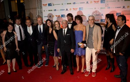 """Stock Photo of Thierry Ragobert French Director Thierry Ragobert, front center, poses for photos with his crew as they arrive for the premiere of his film """"Amazonia"""" at the opening of the Rio de Janeiro Film Festival in Rio de Janeiro, Brazil"""