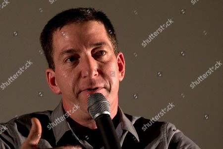 """Glenn Greenwald Journalist Glenn Greenwald talks during a panel following the screening of the """"Dirty Wars"""" documentary at the Rio Film Festival in Rio de Janeiro, Brazil, . Greenwald, who has thousands of leaked National Security Archive documents, participated on a panel with American journalist Jeremy Scahill following the screening of the documentary """"Dirty Wars"""" based on his book by the same name about covert operations"""