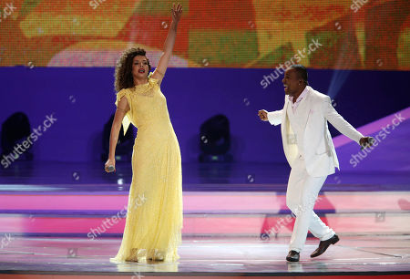 Brazilian singer Vanessa da Mata, left, and singer Alexandre Pires perform during the draw ceremony for the 2014 soccer World Cup in Costa do Sauipe near Salvador, Brazil
