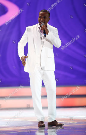 Singer Alexandre Pires performs during the draw ceremony for the 2014 soccer World Cup in Costa do Sauipe near Salvador, Brazil