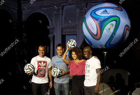 Stock Image of Brazuca, Clarence Seedorf, Cafu, Sheron Menezes From right, Dutch soccer player Clarence Seedorf, Brazilian model Sheron Menezes, Brazilian soccer player Hernanes and former Brazilian player Cafu pose holding the 2014 World Cup official soccer ball, called Brazuca, after it was unveiled in Rio de Janeiro, Brazil