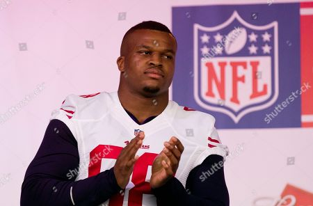 Lawrence Okoye San Francisco 49ers injured British defensive end Lawrence Okoye applauds as he stands on stage during an NFL fan rally in Trafalgar Square, London, . The San Francisco 49ers are due to play the the Jacksonville Jaguars at Wembley stadium in London on Sunday, Oct. 27 in a regular season NFL game