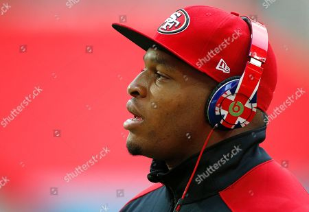 San Francisco 49ers player Lawrence Okoye looks up during the warm-up at Wembley Stadium in London ahead of the NFL football game between San Francisco 49ers and Jacksonville Jaguars, . San Francisco 49ers player Okoye is injured and will not play in the match