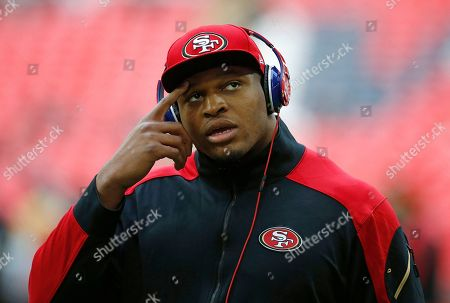 San Francisco 49ers player Lawrence Okoye gestures during the warm-up at Wembley Stadium in London ahead of the NFL football game between San Francisco 49ers and Jacksonville Jaguars, . Okoye is injured and will not play in the match