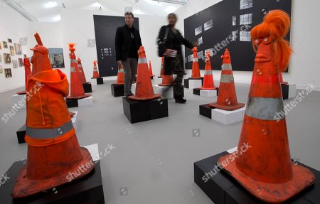 Visitors walk through a work by American artist Rob Pruitt featuring traffic cones at the Frieze Art Fair in London's Regent's Park, . Frieze London coincides with Frieze Masters and features work from over 1000 artists across 150 of the leading contemporary art galleries working today