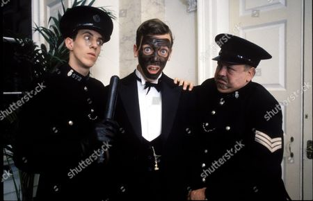 Stock Photo of 'Jeeves and Wooster' - Constable Dobson [William Waghorn], Bertie Wooster [Hugh Laurie] and Sargent Voules [Dave Atkins]