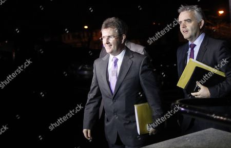 Democratic Unionist Party member Jeffrey Donaldson and Jonathan Bell, right, arrive for political talks at the Stormont Hotel, Belfast, Northern Ireland, . They arrived to hold meetings with Richard Haass and Meghan O'Sullivan and talks with Northern Ireland's five main parties. They are trying to reach an agreement on revised proposals on dealing with the past. The parties spent the day studying revised proposals from the former US diplomat. Haass and Harvard professor Meghan O'Sullivan were brought to Northern Ireland in July by the first and deputy first ministers, with an aim of finding consensus on flags, parades and the past by the end of the year