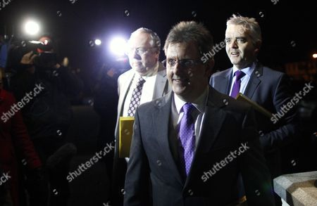 Democratic Unionist Party members Jeffrey Donaldson, centre and Jonathan Bell, right, arrive with Mervyn Gibson, left, Senior member of the Orange Order for political talks at the Stormont Hotel, Belfast, Northern Ireland, . They arrived to hold meetings with Richard Haass and Meghan O'Sullivan and talks with Northern Ireland's five main parties. They are trying to reach an agreement on revised proposals on dealing with the past. The parties spent the day studying revised proposals from the former US diplomat. Haass and Harvard professor Meghan O'Sullivan were brought to Northern Ireland in July by the first and deputy first ministers, with an aim of finding consensus on flags, parades and the past by the end of the year