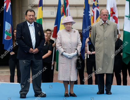 Elizabeth II Britain's Queen Elizabeth II, centre, accompanied by the Duke of Edinburgh, right, and Prince Imran of Malaysia, left, President of the Commonwealth Games Federation attend the 2014 Glasgow Commonwealth Games Baton relay launch ceremony at the Buckingham Palace in London