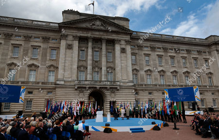 Elizabeth II Britain's Queen Elizabeth II, bottom center, accompanied by the Duke of Edinburgh, right, and Prince Imran of Malaysia, left, President of the Commonwealth Games Federation attend the 2014 Glasgow Commonwealth Games Baton relay launch ceremony at the Buckingham Palace in London