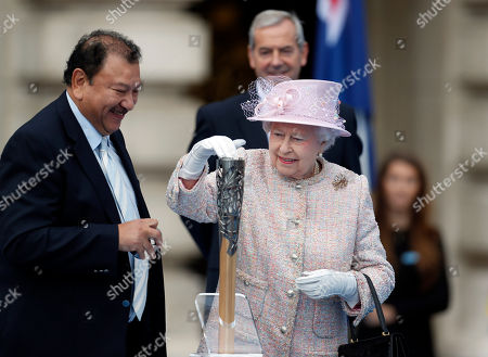 Elizabeth II Britain's Queen Elizabeth II places her message to the Commonwealth Games in the Commonwealth Games Baton, as Prince Imran of Malaysia, left, President of the Commonwealth Games Federation, looks on during its launch ceremony at the Buckingham Palace in London, . Over a period of 288 days the baton will be relayed by thousands of people throughout the Commonwealth, will visit 70 nations and territories, cover 190,000 kilometres and involve a third of the world's population, according to the organizers. The 2014 Commonwealth Games will be held in Glasgow, Scotland between July 23 to Aug. 3, 2014