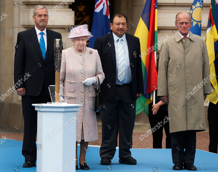 Elizabeth II Britain's Queen Elizabeth II, 2nd left, accompanied by the Duke of Edinburgh, right, Prince Imran of Malaysia, 2nd right, President of the Commonwealth Games Federation and Lord Robert Smith, left, chairman of the 2014 Glasgow Commonwealth Games Organizing Committee attend the Games Baton relay launch ceremony at the Buckingham Palace in London