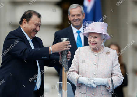 Elizabeth II Britain's Queen Elizabeth II looks on as Prince Imran of Malaysia, left, President of the Commonwealth Games Federation, closes the baton after she placed her message inside, during its relay launch ceremony at the Buckingham Palace in London, . Over a period of 288 days the baton will be relayed by thousands of people throughout the Commonwealth, will visit 70 nations and territories, cover 190,000 kilometres and involve a third of the world's population, according to the organizers. The 2014 Commonwealth Games will be held in Glasgow, Scotland between July 23 to Aug. 3, 2014