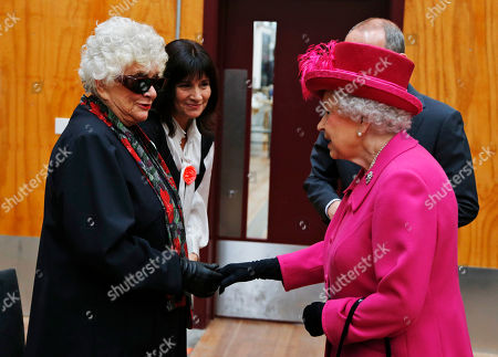 Elizabeth II Britain's Queen Elizabeth II, right, meets Lady Olivier, left, widow of Sir Laurence Olivier, during a visit at the National Theatre in London, to commemorate the institution's 50th anniversary