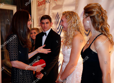 Stock Image of Britain's Duchess of Cambridge, left, Patron of SportsAid charity, meets British rower Jess Leyden, 18, 2nd right, as she attends the SportsBall, the charity's annual gala dinner, in London, . According to the charity, SportsAid helps the next generation of British sports stars by giving them financial support and recognition during the critical early years of their careers