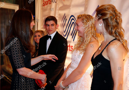 Stock Photo of Britain's Duchess of Cambridge, left, Patron of SportsAid charity, meets British rower Jess Leyden, 18, 2nd right, and other young athletes as she attends the SportsBall, the charity's annual gala dinner, in London, . According to the charity, SportsAid helps the next generation of British sports stars by giving them financial support and recognition during the critical early years of their careers