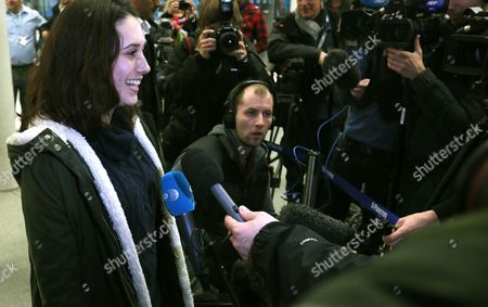 Greenpeace activist Alexandra Harris, who was one of the 30 crew arrested by Russia, speaks to the media after arriving in London, . Russian investigators have dropped charges against all but one of the 30 crew of a Greenpeace ship, who were accused of hooliganism following a protest outside a Russian oil rig in the Arctic, the group said Wednesday. The criminal charges against the crew were closed under an amnesty that was passed by the parliament earlier this month, seen by many as an attempt by the Kremlin to dampen the criticism of Russia's human rights record before the Winter Olympics in Sochi in February