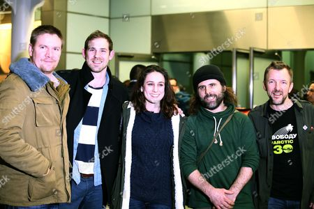 The five British Greenpeace activists, crew members and video journalist who were part of the 30 Greenpeace crew arrested in the Russian Arctic pose for the media as they arrive back in London, from left: Anthony Perrett, activist, Kieron Bryan, freelance videographer, Alexandra Harris, activist, Ian Roger, crew member and Phill Ball, activist, . The crew members were detained in September and charged with piracy after some of them aboard the Arctic Sunrise boat attempted to scale an offshore drilling platform owned by Russia's state-owned natural gas giant Gazprom. Those allegations were later downgraded to hooliganism before being dropped altogether following the passage of an amnesty law widely interpreted as an attempt by Moscow to temper foreign criticism of Russia's human rights record before the Winter Olympics to be held in Sochi, Russia, in February