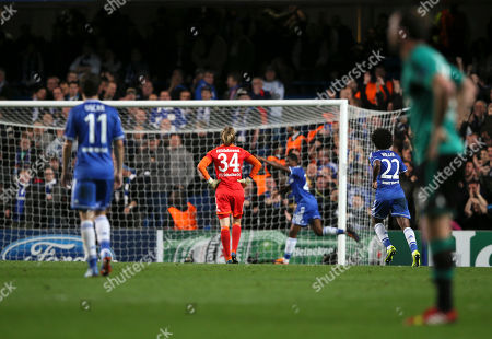 Chelsea's Samuel Eto'o, centre, raids his arm in celebration after scoring the first goal past Schalke goalkeeper Timo Hildebrand during the Champions League group E soccer match between Chelsea and FC Schalke 04 at Stamford Bridge stadium in London
