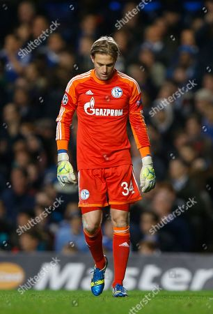 Schalke goalkeeper Timo Hildebrand looks at the ground after making a mistake to gift Chelsea a goal during the Champions League group E soccer match between Chelsea and FC Schalke 04 at Stamford Bridge Stadium in London