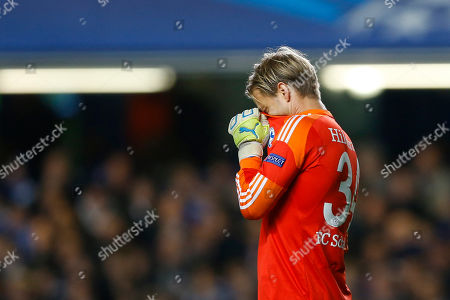 Schalke goalkeeper Timo Hildebrand hides his head in his shirt after making a mistake to gift Chelsea a goal during the Champions League group E soccer match between Chelsea and FC Schalke 04 at Stamford Bridge Stadium in London