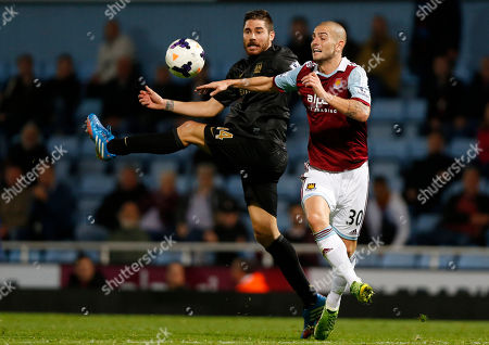 Mladen Petric, Javi Garcia West Ham United's Mladen Petric, right, competes with Manchester City's Javi Garcia during their English Premier League soccer match at Upton Park, London