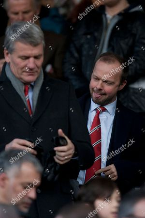 Manchester United's executive vice-chairman Edward Woodward, right, stands near former chief executive David Gill before the team's English Premier League soccer match against West Ham United at Old Trafford Stadium, Manchester, England