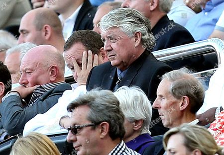Newcastle United's owner Mike Ashley, left, and director of football Joe Kinnear, right, look on from the stands during their English Premier League soccer match against Hull City at St James' Park, Newcastle, England