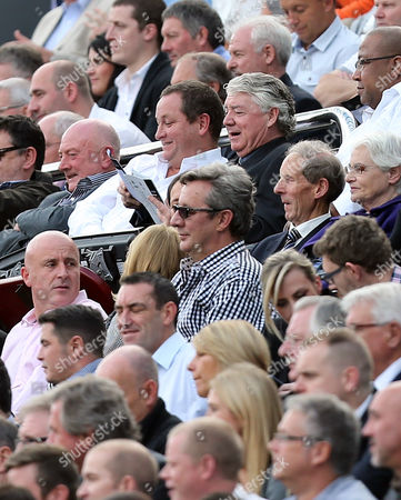 Stock Picture of Newcastle United's owner Mike Ashley, left, and director of football Joe Kinnear, right, read the program on the stands during their English Premier League soccer match against Hull City at St James' Park, Newcastle, England