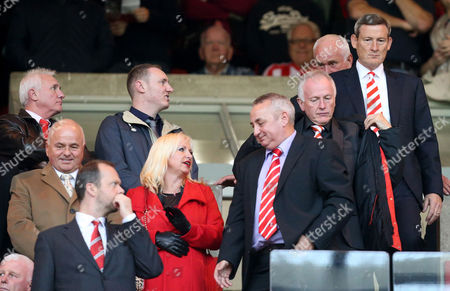 Sunderland's owner Ellis Short, top right, looks on from the stand ahead of their English Premier League soccer match against Manchester United at the Stadium of Light, Sunderland, England