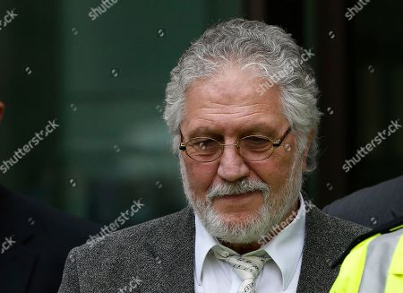 Dave Lee Travis British DJ Dave Lee Travis leaves after appearing at Westminster Magistrates' Court to answer charges of assaulting a woman aged over 16 between Jan. 1, 1992 and Dec. 31, 1993, London, . Travis has already appeared in court to face 12 other counts, including indecent assault and sexual assault