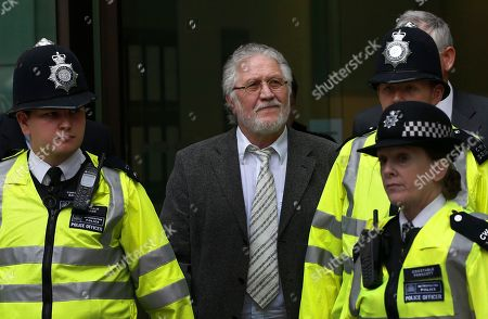 Stock Picture of Dave Lee Travis British DJ Dave Lee Travis, center, is escorted by British police officers after appearing at Westminster Magistrates' Court to answer charges of assaulting a woman aged over 16 between Jan. 1, 1992 and Dec. 31, 1993, London, . Travis has already appeared in court to face 12 other counts, including indecent assault and sexual assault