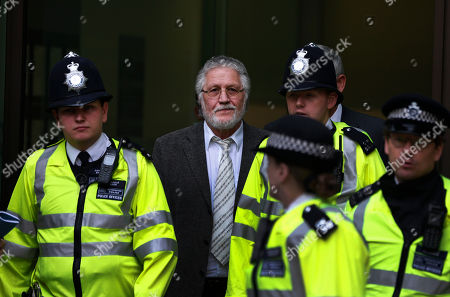 Dave Lee Travis British DJ Dave Lee Travis, center, is escorted by British police officers after appearing at Westminster Magistrates' Court to answer charges of assaulting a woman aged over 16 between Jan. 1, 1992 and Dec. 31, 1993, London, . Travis has already appeared in court to face 12 other counts, including indecent assault and sexual assault