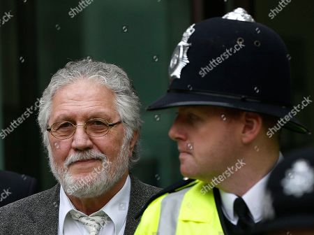 Dave Lee Travis British DJ Dave Lee Travis, left, is escorted by British police officers after appearing at Westminster Magistrates' Court to answer charges of assaulting a woman aged over 16 between Jan. 1, 1992 and Dec. 31, 1993, London, . Travis has already appeared in court to face 12 other counts, including indecent assault and sexual assault