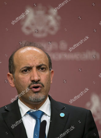 Member of the Syrian Opposition Coalition and the groups President Ahmed Jarba speaking to the media at the British Foreign Office in London . Foreign ministers and representatives of eleven nations from the West and Mideast met in London on Tuesday to discuss ways to reach a negotiated end to the war in Syria