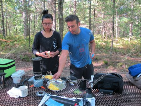 Jennifer Li, left, and David Zorn of Los Angeles prepare a hurried breakfast at Sleeping Bear Dunes National Lakeshore near Empire, Mich. They were ordered to leave as the park that was closing because of the partial federal government shutdown