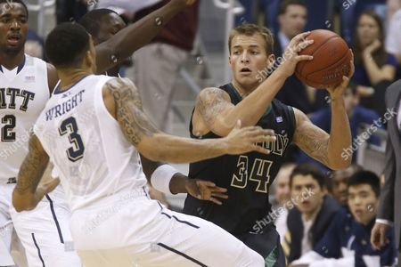 Brian Bennett Cal Poly's Brian Bennett (34) passes as Pittsburgh's Cameron Wright defends in the first half of the NCAA college basketball game, in Pittsburgh