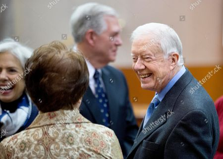 Jimmy Carter Former President Jimmy Carter, right, meets with guests at an event marking the declassifying of documents used in his preparation to negotiate what became the first treaty between the Jewish state of Israel and Egypt, at the Carter Center, in Atlanta. The Central Intelligence Agency has declassified 1,400 pages of intelligence related to the Camp David Accords that Carter negotiated in 1978 with the leaders of Israel and Egpyt. The documents include political and personality profiles of Egyptian President Anwar Sadat and Israeli Prime Minister Menachem Begin that Carter read before the 13-day summit at the presidential retreat