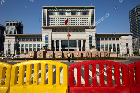 A traffic policeman stands in front of Shandong Province Supreme People's Court in Jinan, in eastern China's Shandong province, . The court will hold a hearing on Friday to rule on disgraced politician Bo Xilai's appeal against the guilty verdict and life imprisonment he was handed last month. Bo was found guilty of embezzlement, bribery and abuse of power by a lower court last month and sentenced to life in prison. He has denied the charges