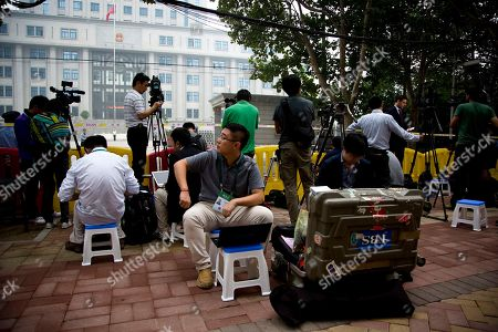 Journalists wait for former politician Bo Xilai to arrive at the Jinan Intermediate People's Court in Jinan in eastern China's Shandong province on . The Chinese court was expected to hand down a guilty verdict Sunday for corruption charges against fallen politician Bo Xilai in one of the country's most lurid political scandals in decades