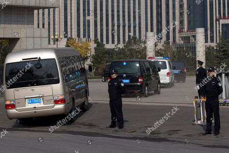 A convoy of vehicles believed to be carrying ousted Chinese politician Bo Xilai enter Shandong Provincial Higher People's Courtwhere ruling to Bo's appeal against his conviction will be handed down, in Jinan, in eastern China's Shandong province