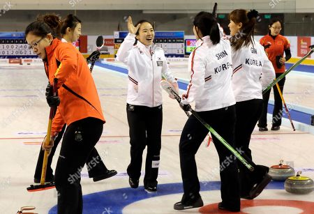 Kim Ji-sun, Gim Un-chi, Shin Mi-Sung, Lee Seul-bee South Korea's players from left in white jersey, Lee Seul-bee, Kim Ji-sun, Shin Mi-Sung, Gim Un-chi celebrate after defeating China during the final match of the Pacific-Asia Curling Championships at the Fei Yang Skating Center in Shanghai, China