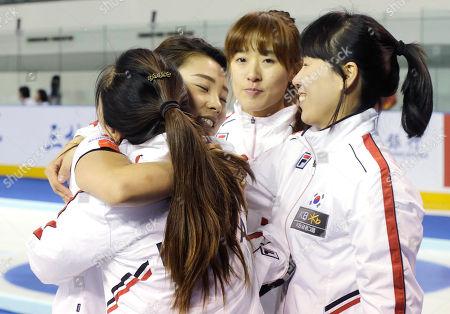 Kim Ji-sun, Gim Un-chi, Shin Mi-Sung, Lee Seul-bee South Korea's players from left, Kim Ji-sun, Lee Seul-bee, Gim Un-chi, Shin Mi-Sung celebrate after defeating China during the final match of the Pacific-Asia Curling Championships at the Fei Yang Skating Center in Shanghai, China
