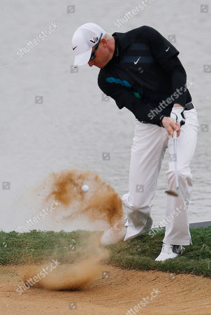 Stock Image of Simon Dyson Simon Dyson of England hits out of a bunker on the 18th green during the second round of the BMW Masters golf tournament at the Lake Malaren Golf Club in Shanghai, China