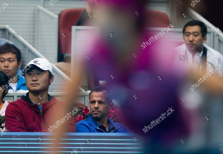 Jiang Shan, Carlos Rodriguez China's Li Na husband Jiang Shan, left, and her coach Carlos Rodriguez, center, watch Li Na plays against Daniela Hantuchova of Slovakia during their first round of the China Open tennis tournament at the National Tennis Stadium in Beijing, China on