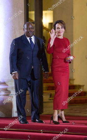 SENTENCEThe president of Gabon Ali Bongo Ondimba, left, and his wife Sylvia, pose for photographs prior to attending an official dinner as part of the Elysee Summit for Peace and Security in Africa at the Elysee Palace, in Paris. France is hosting dozens of African leaders for a summit on security, just as the French military is launching an intervention in the Central African Republic and encouraging African governments to take more responsibility for peacemaking on the continent
