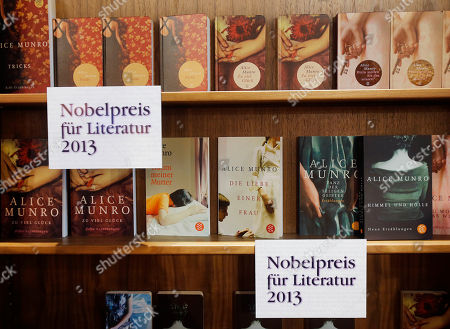 Books of Canadian writer Alice Munro who won the Nobel Prize for literature are presented at the Book Fair in Frankfurt, Germany, Thursday, Oct.10, 2013