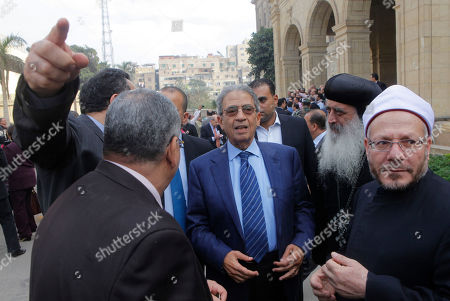 Amr Moussa, Shawqi Allam, Bishop Bola CORRECTS NAME OF BISHOP - Amr Moussa, the chairman of Egypt's 50-member panel tasked with amending Egypt's Islamist-drafted constitution, center, talks to Egypt's Grand Mufti Shawqi Allam, right, and a representative of the Orthodox Church, Bishop Bola, second right, after finishing the final draft of a series of constitutional amendments at the Shoura Council in Cairo, Egypt, . Adoption of the new charter will be a giant step in the implementation of the roadmap announced by the nation's military chief when he toppled Morsi in a July 3 coup. The next steps will be parliamentary and presidential elections in the spring and summer of 2014