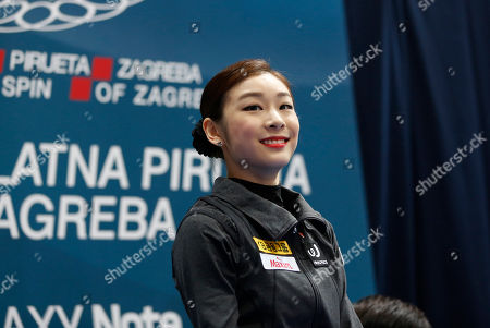 South Korea's Kim Yu-Na smiles after seeing results, which place her first, in the free skating of the Golden Spin figure skating competition in Zagreb, Croatia